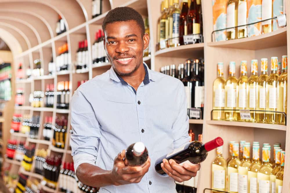 African,Man,As,A,Customer,With,Two,Bottles,Of,Wine